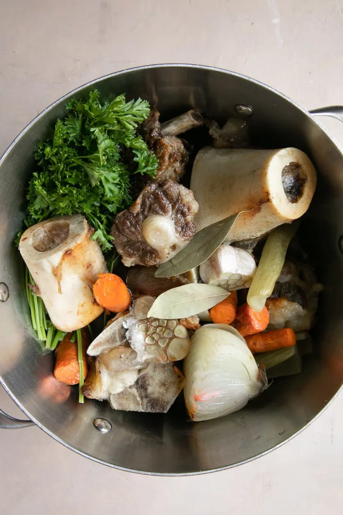 Stockpot filled with everything you need to make beef broth.
