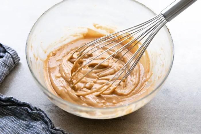 Prepared Thai peanut sauce in a glass bowl.