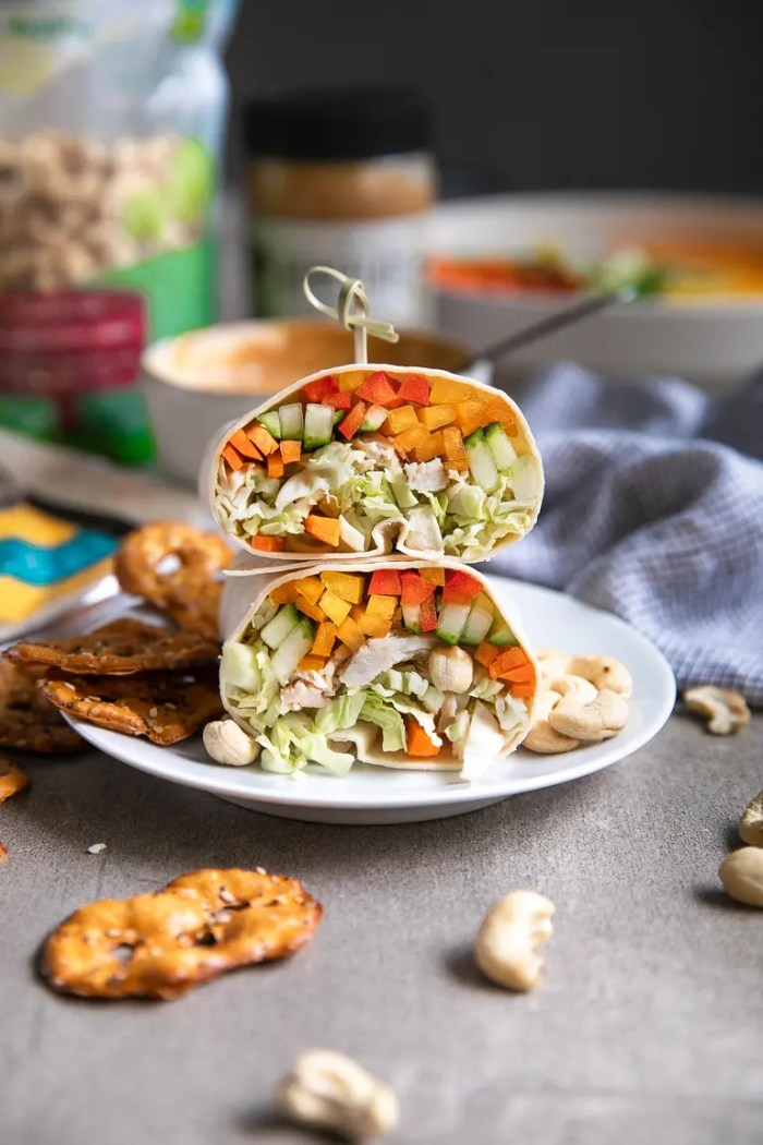 Thai chicken wrap with bell pepper, cucumber, carrots, cabbage and Thai peanut sauce.