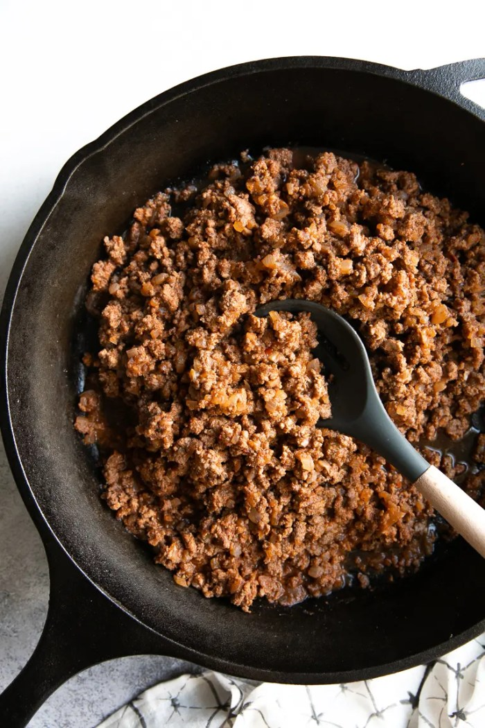 Cast Iron Skillet filled with ground beef taco meat.