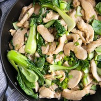 Overhead image of Chicken and bok choy stir fry in a light sauce.