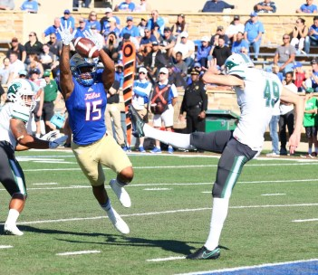 University of Tulsa defensive end Trevis Gipson (15) comes within inches of blocking a punt Saturday in TU's 50-27 victory over Tulane. (PHOTO: John E. Hoover)