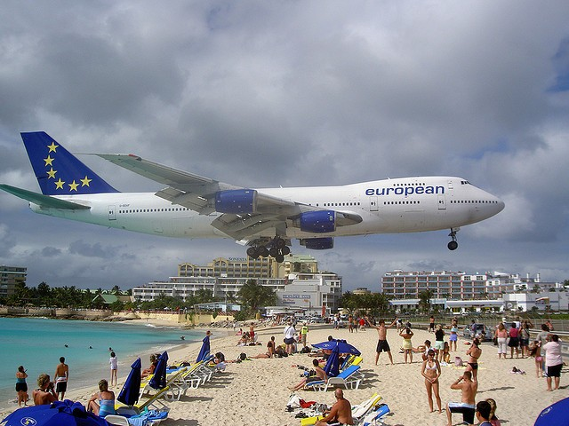 low flying plane beach