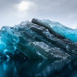 Photographer captures rare blue iceberg
