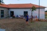 Sun setting on the village hall and christening party.