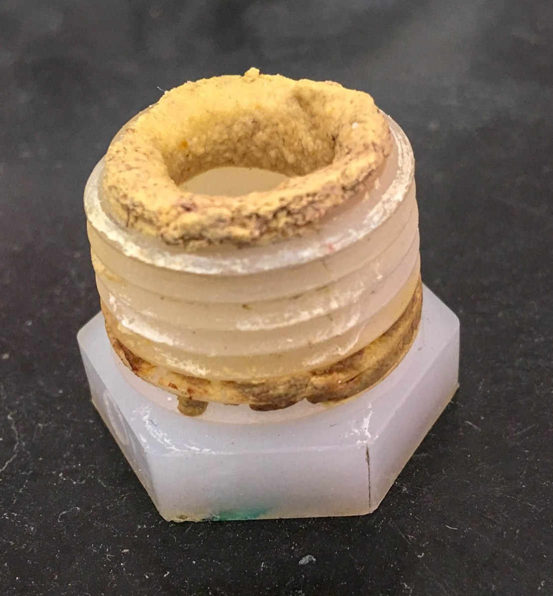 Original Atwood Hot Water Heater Drain Plug With Some Sort of Brown Sealer Material