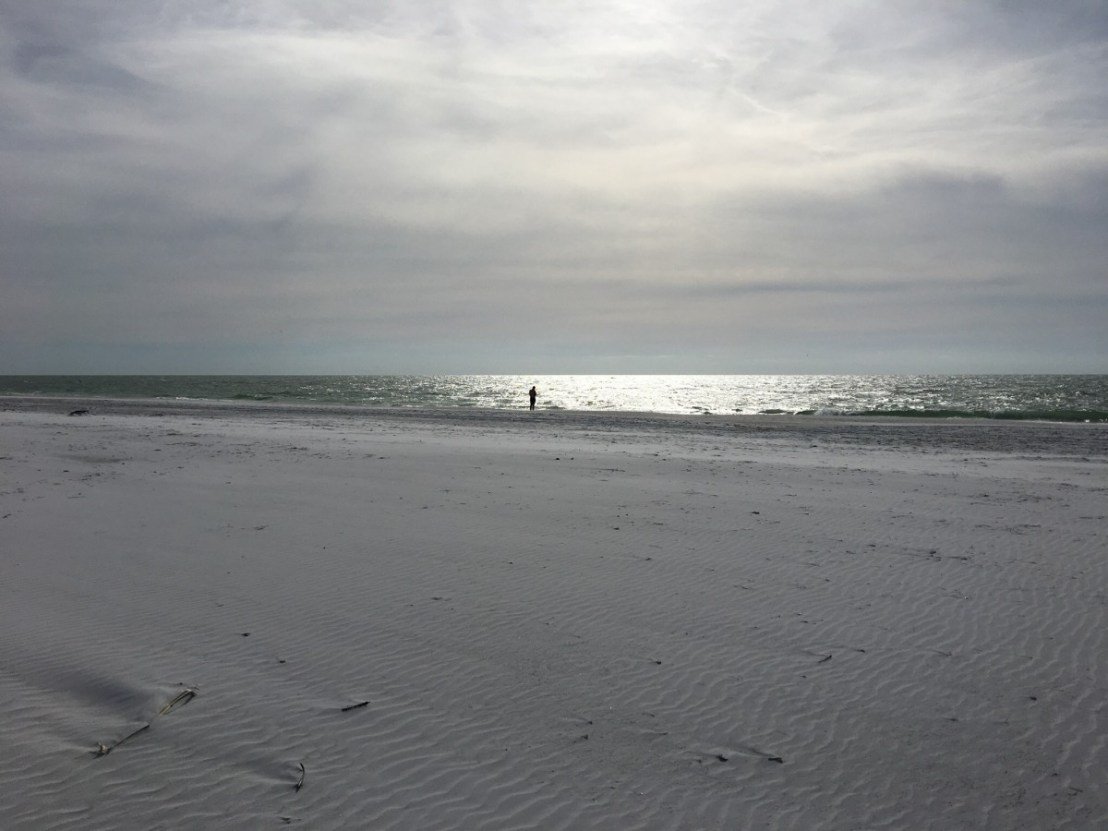Looking West Out Towards The Gulf Of Mexico Across Wide Sand Beach