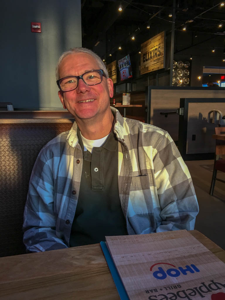 Larry Sitting In Courtyard Applebee's Restaurant