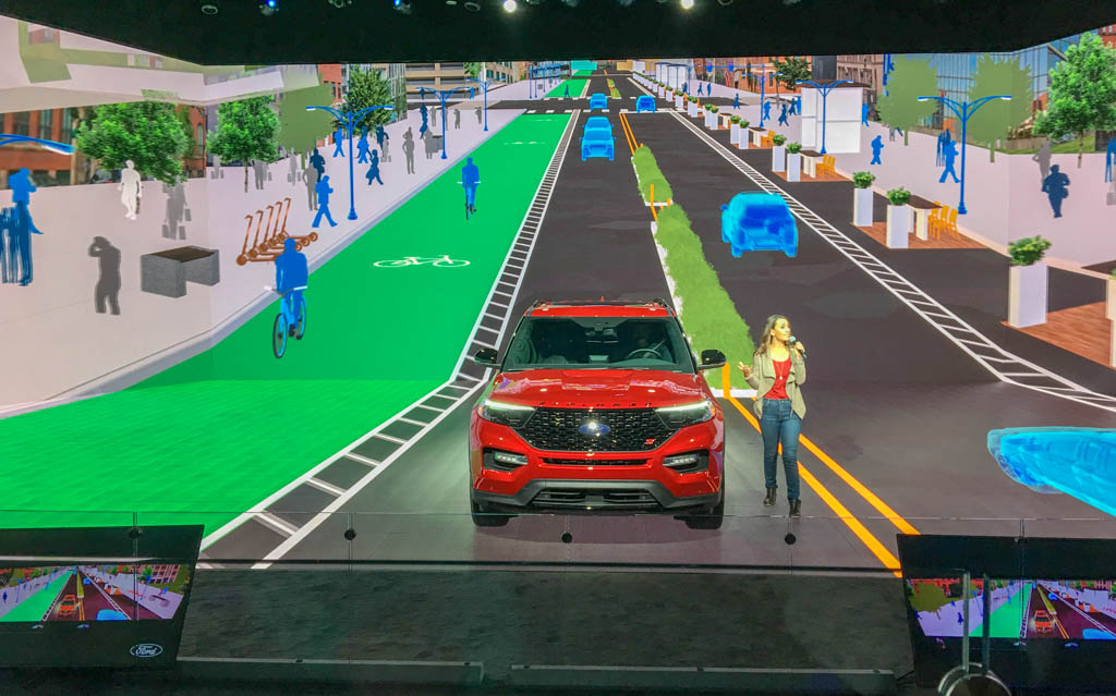 Presenter Showing Ford Explorer Center Stage