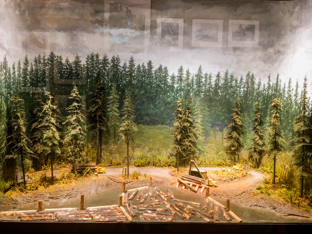 Diorama Showing Logs Being Dumped Into River For Delivery To Mill Downstream