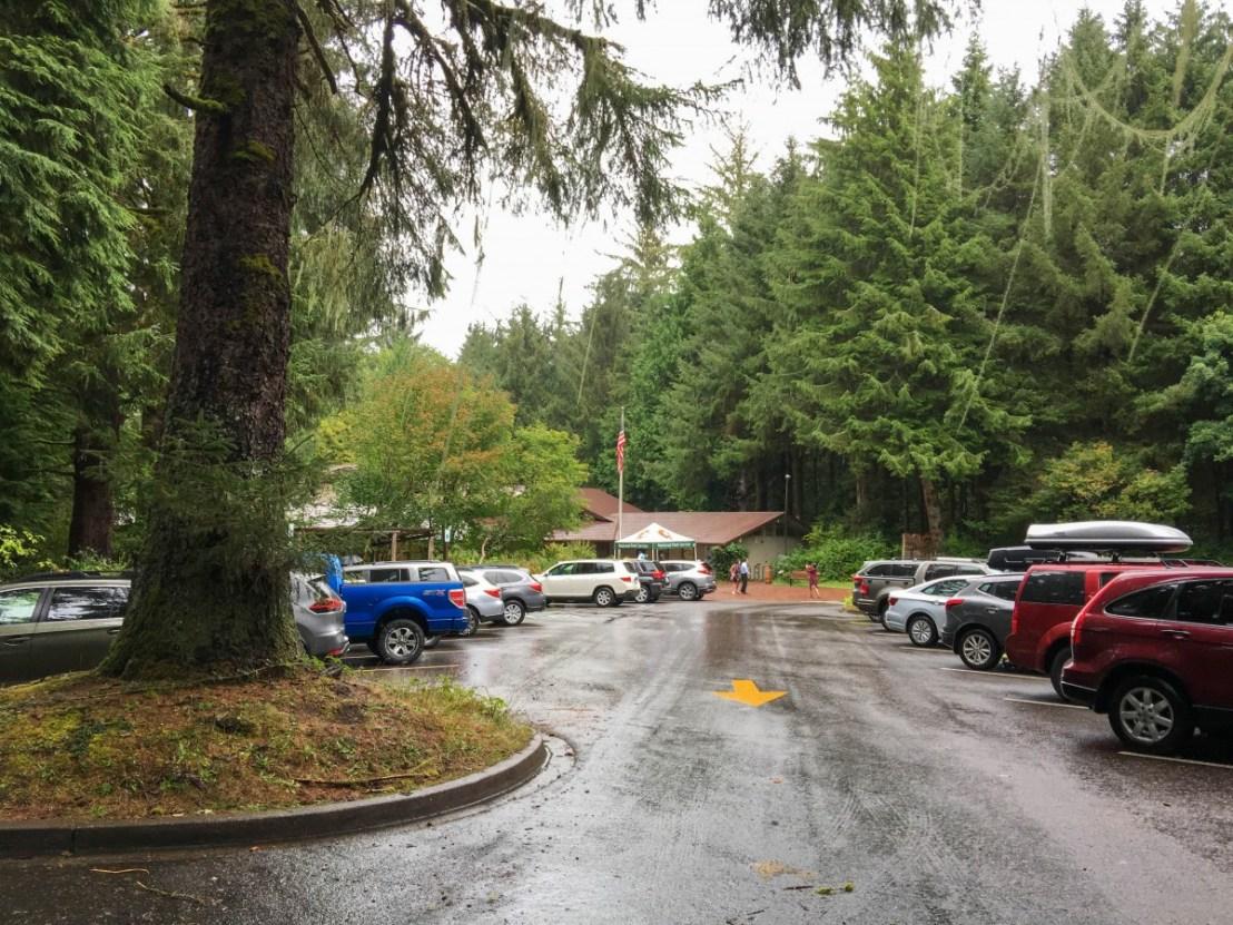 Visitor Center Seen Through Full Parking Lot