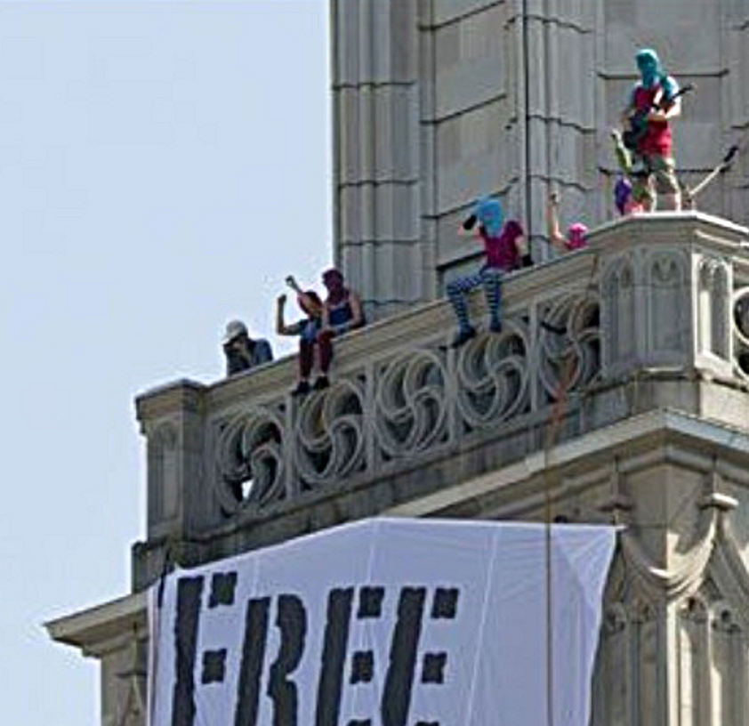 PUSSY RIOT SUPPORTERS OCCUPY FRAUMÜNSTER TOWER IN ZURICH  (2/2)