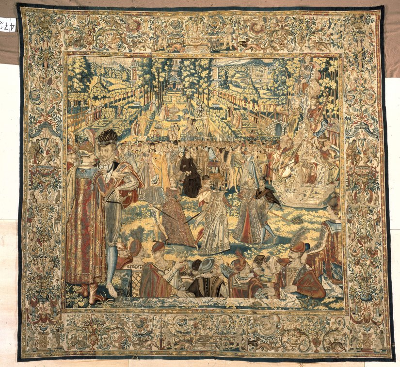 Three four-string viols on a tapestry depicting a ball held by Catherine de' Medici in 1573.