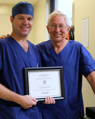 Dr Juston Roe with award