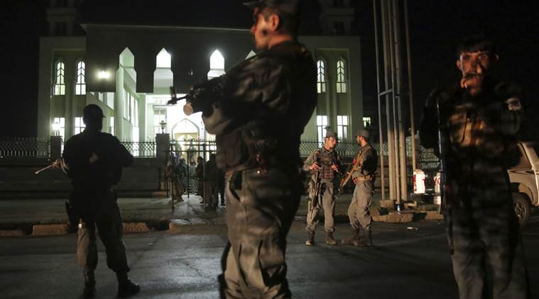 Security forces respond at the site of a suicide attack on a Shiites mosque in Kabul, Afghanistan, Thursday, Jun 15, 2017.   A suicide bomber struck outside a Shiite mosque in the Afghan capital Kabul late Thursday night, killing a leader of Afghanistan's ethnic Hazaras, Hajji Ramazan Hussainzada, and others. (AP Photos/Massoud Hossaini)