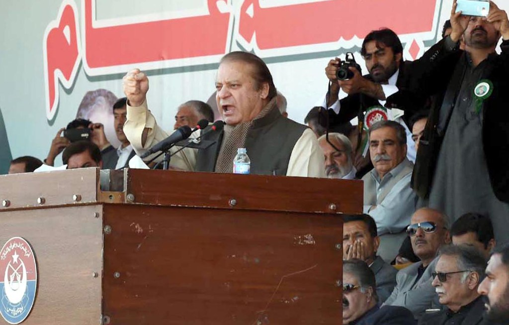 QUETTA:  Former Prime Minister Nawaz Sharif addressing a rally of Pakhtunkhwa Milli Awami Party (PkMAP) on the occasion of the 44th death anniversary of Abdul Samad Khan Achakzai at Ayyub Stadium. INP PHOTO by Adnan Ahmed