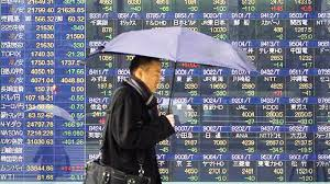 Asian markets mixed after trade talks, Aussie dollar pares losses
