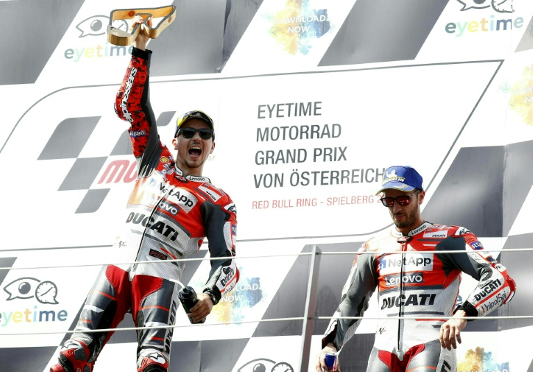 Lorenzo holds off Marquez to win Austrian MotoGP