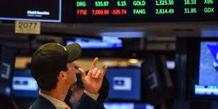 Stock markets diverge, investors guarded over trade deals