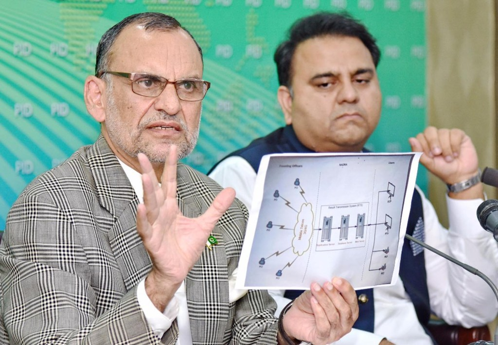 ISLAMABAD: Senator Azam Khan Swati along with  Federal Minister for Information and Broadcasting Chaudhry Fawad Hussain addressing a press conference. INP PHOTO