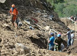 Philippine miners dig for their own in landslide