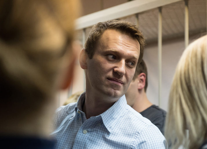 Russian anti-Kremlin opposition leader Alexei Navalny attends the verdict announcement on his criminal case at a court in Moscow on December 30, 2014. A Russian court on December 30 handed a 3.5-year suspended sentence to top Kremlin critic Alexei Navalny in his controversial fraud trial, after abruptly moving forward the reading of the verdict. Judge Yelena Korobchenko found Navalny and his brother Oleg guilty of embezzlement. But while Navalny received a suspended sentence, his brother was handed a 3.5-year prison term and handcuffed in the courtroom in a move that Navalny angrily denounced as political 'pressure.' AFP PHOTO / DMITRY SEREBRYAKOV        (Photo credit should read DMITRY SEREBRYAKOV/AFP/Getty Images)