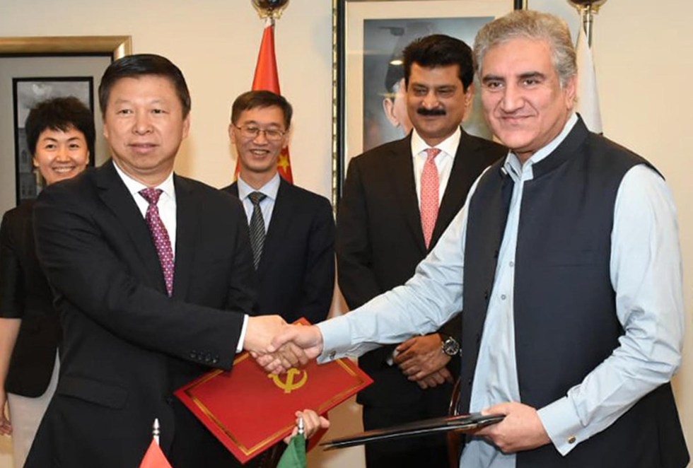 Pic14-017 ISLAMABAD: Oct 14 – Foreign Minister Shah Mehmood Qureshi and Minister of the International Department of the Central Committee of the Communist Party of China, Song Tao exchange documents after signing the MOU between Pakistan Tehreek-e-Insaf (PTI) and Communist Party of China to further strengthen party to party relations. ONLINE PHOTO