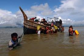 Dozens of Rohingya flee camps by boat