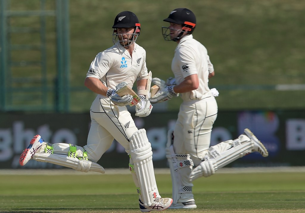 New Zealand captain Kane Williamson (L) and teammate Henry Nicholls run between wickets during the fourth day of the third and final Test cricket match between Pakistan and New Zealand at the Sheikh Zayed International Cricket Stadium in Abu Dhabi on December 6, 2018. (Photo by AAMIR QURESHI / AFP)        (Photo credit should read AAMIR QURESHI/AFP/Getty Images)
