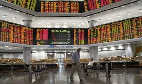 Asian shares mostly lower as investors watch trade talks