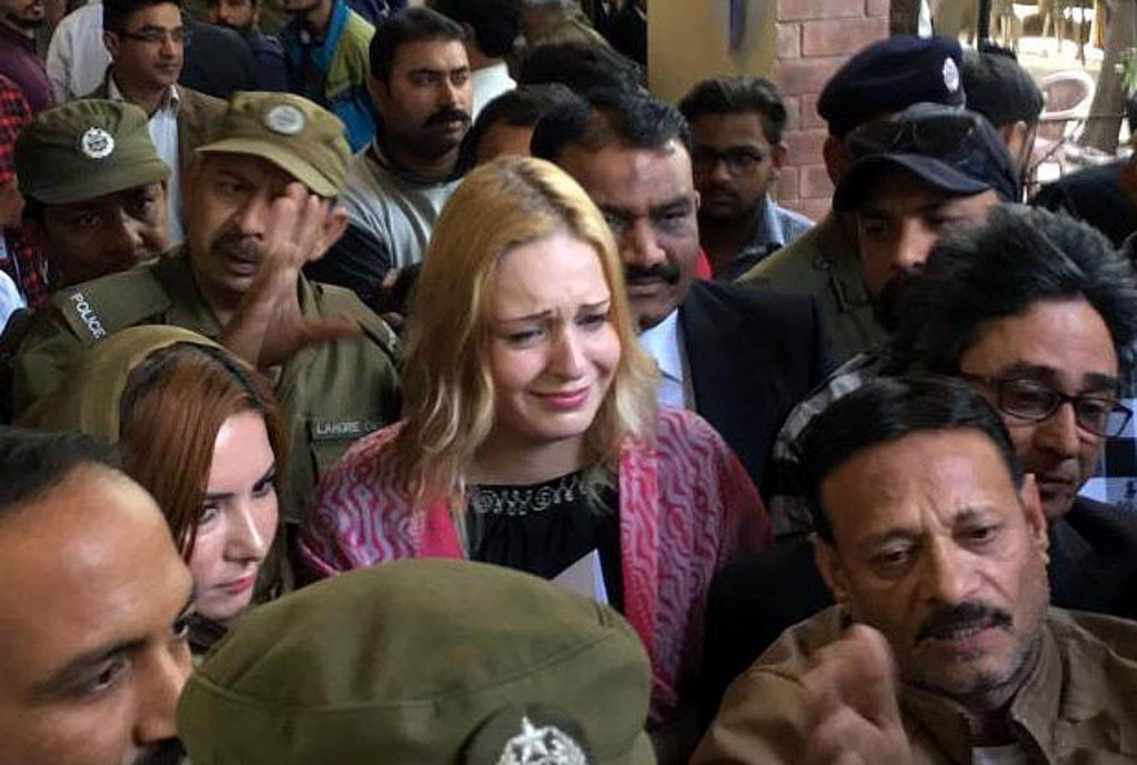 LAHORE: Arrested foreign model Teresa came out court after has been awarded 8 years and 8 months sentence in heroin smuggling case. INP PHIOTO by Hamid Musa