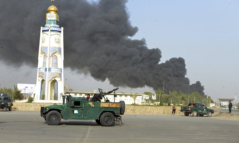 Afghan security forces arrive after a powerful explosion outside the provincial police headquarters in Kandahar province south of Kabul, Afghanistan, Thursday, July 18, 2019. A Taliban fighter in southern Kandahar province attacked the police headquarters with a car bomb, killing himself and at least nine others and wounding dozens more, officials said. (AP Photo)