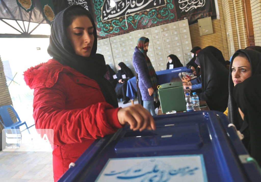 TEHRAN A woman is casting her vote in the 11th parliamentary elections and the mid-term election for the Assembly on February 21, 2020.