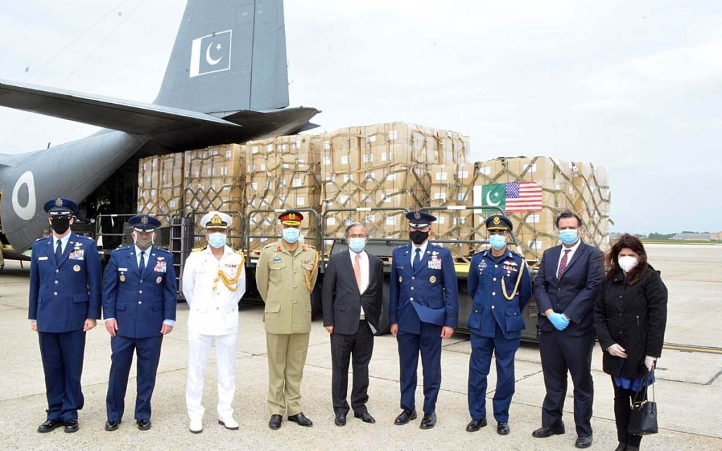 APP18-22 WASHINGTON: May 22 – A group photo of Pakistan Ambassador Dr. Asad M. Khan with officials, as a gesture of solidarity with the United States, a gift of Personal Protective Equipment (PPE) has been made by the Armed Forces of Pakistan to the U.S. Armed Forces. The PPE arrived via a C-130 flight from Islamabad at Andrews Air Force Base (AFB), Maryland this afternoon. APP