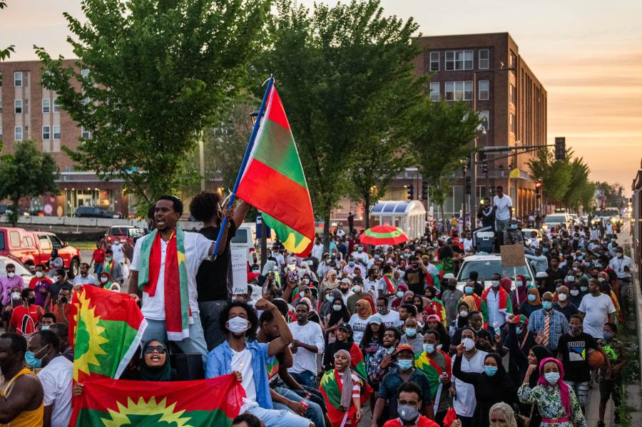 ST PAUL, MN - JULY 01: Demonstrators rejoice while marching down University Avenue during a protest after the death of musician and activist Hachalu Hundessa on July 1, 2020 in St Paul, Minnesota. Hundessa, known for his protest songs which resonated within the Oromo ethnic group, was shot and killed in Ethiopias capital Addis Ababa on June 29, 2020. His death has sparked ongoing protests around the world.   Brandon Bell/Getty Images/AFP == FOR NEWSPAPERS, INTERNET, TELCOS & TELEVISION USE ONLY ==