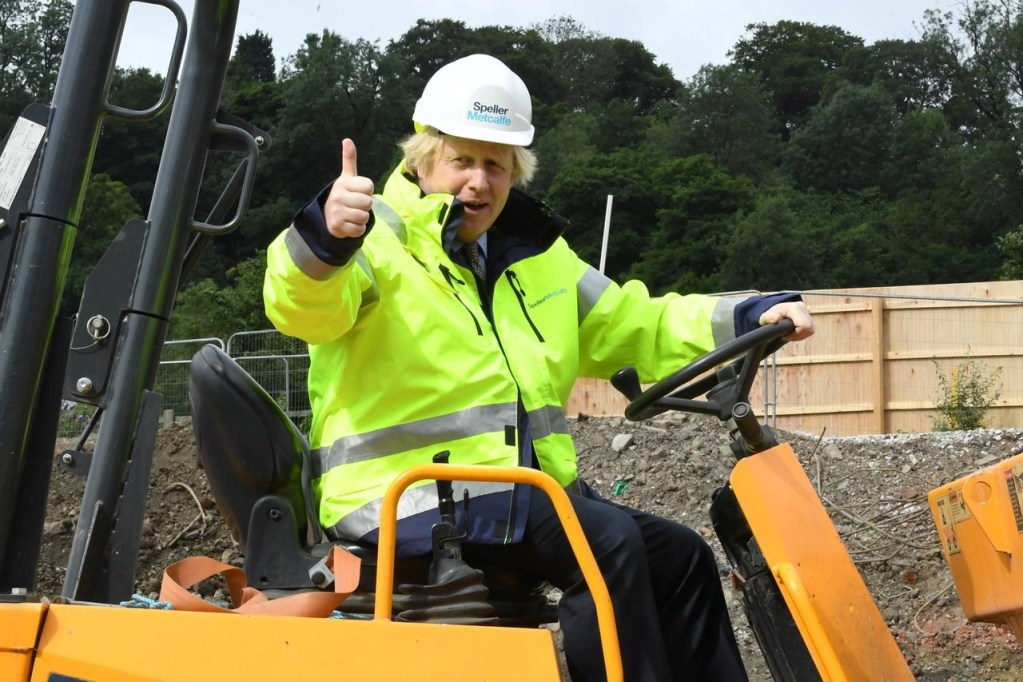 LONDON Britain's Prime Minister Boris Johnson gestures as he visits the Speller Metcalfe's building site for The Dudley Institute of Technology in Dudley, Britain.