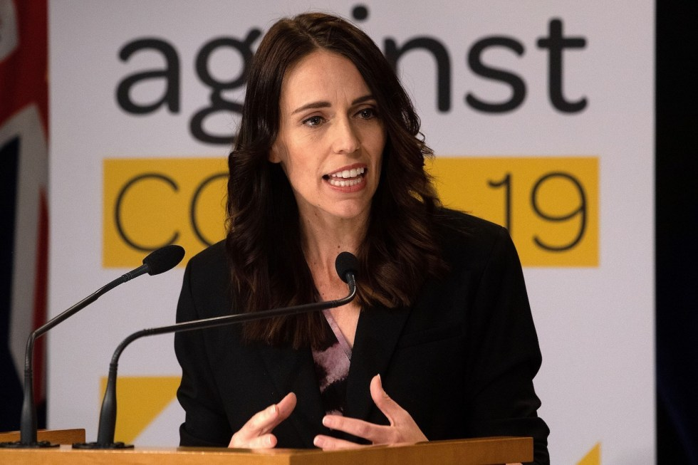 New Zealand's Prime Minister Jacinda Ardern speaks to the media during a press conference one day before the country goes on lockdown to stop any progress of the COVID-19 coronavirus, at Parliament in Wellington on March 24, 2020. (Photo by Marty MELVILLE / AFP)