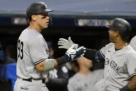 Cole fans 13, Yanks belt 4 homers in rout of Indians