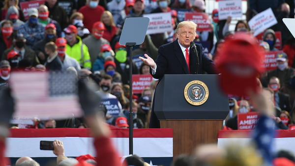 "US President Donald Trump speaks during a campaign rally at Manchester-Boston Regional Airport in Londonderry, New Hampshire on October 25, 2020. - Donald Trump's reelection campaign on Sunday sought to brush off another Covid outbreak in his team by focusing its attacks on Joe Biden's energy levels and accusing him of ""47 years of failure"" in Washington. Nine days before the vote, the US has been engulfed by a surge in Covid-19 cases, reaching a record number of daily infections for a second day running on Saturday with nearly 89,000 new cases. (Photo by MANDEL NGAN / AFP) (Photo by MANDEL NGAN/AFP via Getty Images)"