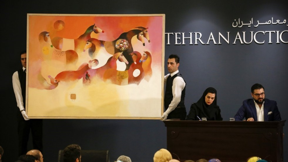 Participants follow the Tehran Art Auction at the Azadi Hotel in Tehran, Iran, Friday, January 11, 2019. Over 1000 enthusiastic art lovers and collectors of Iranian art were present and drove the total sale up by almost 137% over the last Tehran Auction contemporary sale in January 2018. Of about 200 registered bidders in the room, more than 30% were first time bidders. 114 works of art by 105 artists, consisting of 94 paintings, 14 sculptures, and 6 photographs, reached a total of 3,440,300 USD. This was well above the original estimate of around 2,500,000 USD. Out of 114 lots, 113 were sold. Several artists set their national records, including Monir Farmanfarmaian, Hossein Zenderoudi, Jazeh Tabatabie, Koorosh Shishegaran, and Bahman Mohassess. Considering the current economic situation, the success of the auction was a remarkable achievement. (Photo by Rouzbeh Fouladi/NurPhoto)