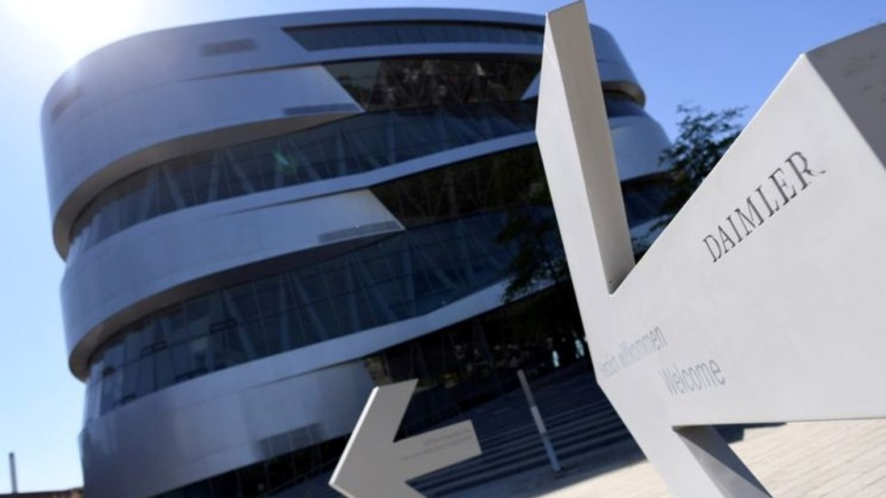 FILE PHOTO: An arrow in front of the Mercedes-Benz Museum shows the way to the Daimler headquarters, as the spread of the coronavirus disease (COVID-19) continues in Stuttgart, Germany, April 22, 2020. REUTERS/Andreas Gebert