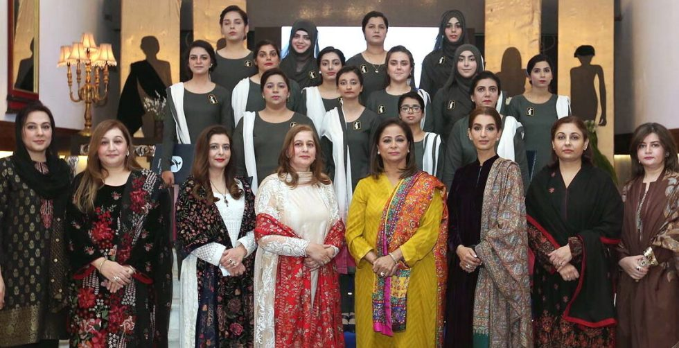 APP11-031220RAWALPINDI: December 03 - Begum Tazeen Mujahid, President PAFWA & Patron-in-Chief PAF Finishing School with the graduation Students and faculty members at the Graduation ceremony of PAF Finishing School, at PAF Officers Mess. APP