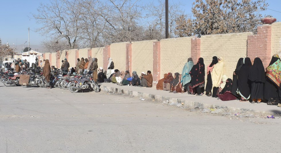 QUETTA: Peoples wait for buying flour on Government price near railway. INP PHOTO by Ahmed Bhatti