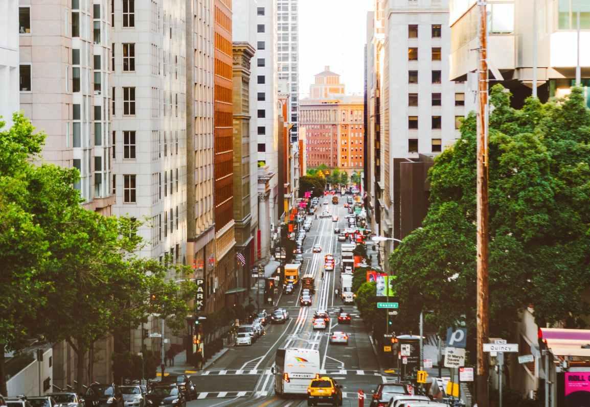 road in between buildings