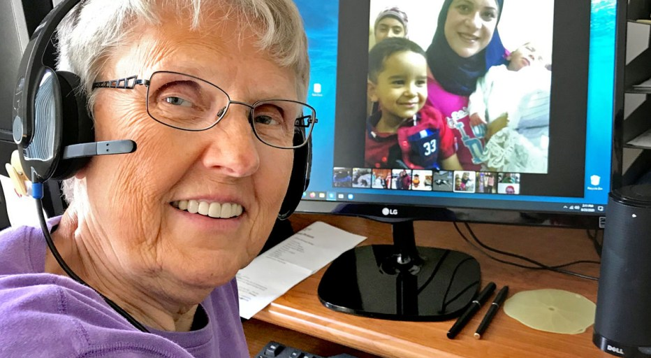 Sr. Pevas is shown at her computer, video conferencing with students.
