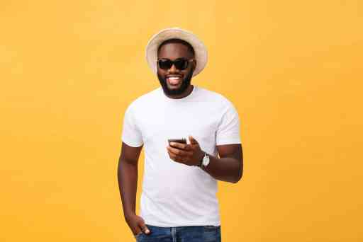 cheerful-african-american-man-white-shirt-using-mobile-phone-application