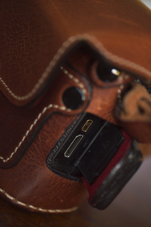 The small flap on the right side of the camera conceals the USBB and HDMI ports.