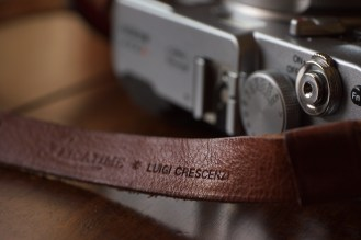Simple, and effective, the adjustable leather strap features Luigi Crescenzi's signature stamp.