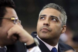 Canadian Al-Jazeera English journalist Mohamed Fahmy, right, listens to his lawyer, Khaled Abou Bakr in Cairo, Egypt, Monday, June 1, 2015. The Canadian journalist imprisoned in Egypt on widely-denounced terror charges has been pardoned by the country's president. THE CANADIAN PRESS/AP, Amr Nabil