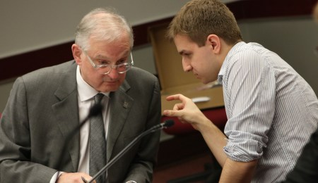 Jamie Ghossein (right), the BOG's undergraduate student representative, consults with U of O president Jacques Frémont prior to Monday's BOG meeting. Photo: Aaron Hemens/Fulcrum